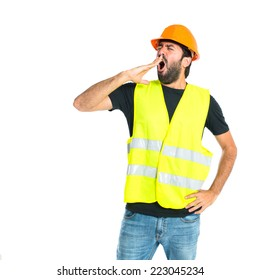 Workman yawning over isolated white background