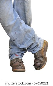Workman's boots and jeans on a white background