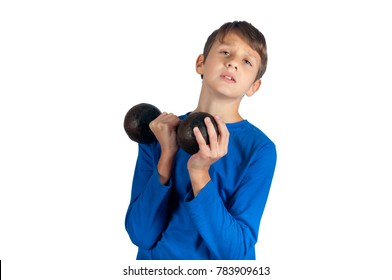 Workout exercises. Teenager in blue pullover trying to raise up metal dumbbell with pressure. Isolated on white