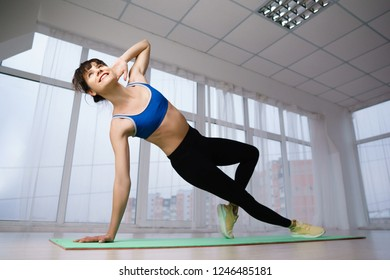 workout, fitness, active lifestyle, health. Sporty woman doing isometric exercise during workout