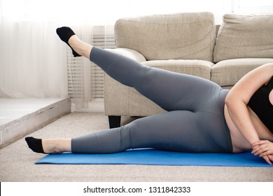 workout, fitness, active lifestyle, health. overweight woman training legs during home workout