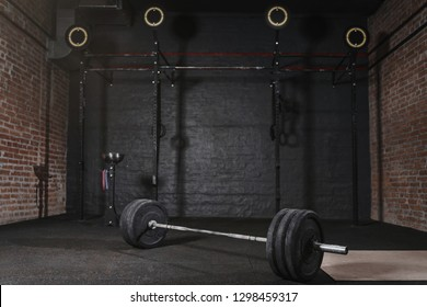 Workout gym with cross fit equipment. Barbell horizontal bars gymnastic rings.