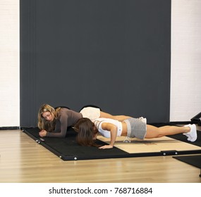 Workout in the gym .Two girls