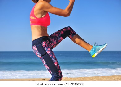 Workout on beach, silhouette of active woman doing exercise