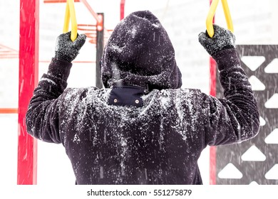 Workout on winter outdoor gym