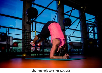 workout training fitness  young girl women in a gym with strong lights on a carpet