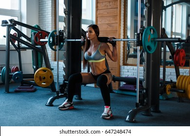 Workout  a woman in the gym. Beautiful young girl doing exercise