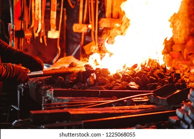 the workpiece lies in the fire in the blacksmith's workshop
