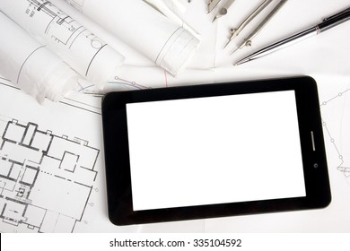 Workplace of architect - Architectural project, blueprints, rolls and tablet, pen, divider compass on plans. Engineering tools view from the top. Construction background. Copy space for text.