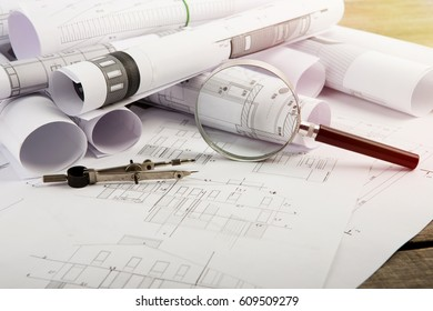 Workplace of architect - construction drawings and tools on the table