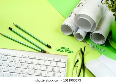 Workplace of architect - Architect rolls and plans.architectural plan,technical project drawing. Engineering tools view from the top. Construction background.