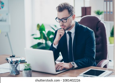 Workplace attorney success collar executive notary broker lawyer people corporate concept. Concentrated serious handsome pensive smart clever broker realtor recruiter using netbook at work