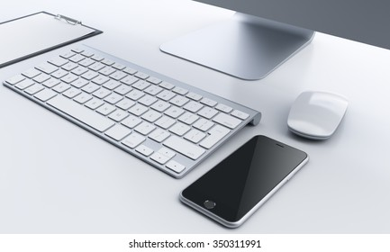 workplace with computer, keyboard, black smartphone and mouse to the right, notepad to the left in the office, concept of work and communication