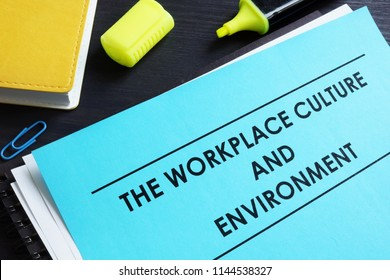 The workplace culture and environment report on a desk.