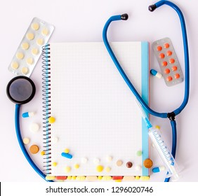 Workplace of doctor - stethoscope, notebook, medical items and pills on desk. The concept of self-medication, social medecine, accessibility, rise in price, budget, planning.