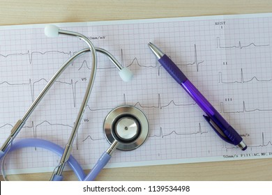 workplace doctor therapist or cardiologist-electrocardiogram, stethoscope and pen
