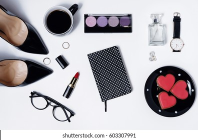 Workplace flat lay with women accessories, diary , coffee and gingerbread isolated on white. Top view