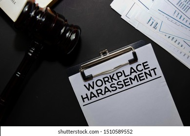 Workplace Harassement text on Document and gavel isolated on office desk. Law concept