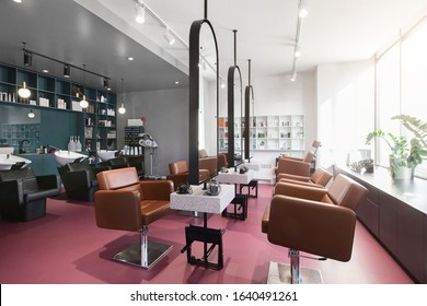 Workplace makeup artist and hairdresser. Nobody. Big mirrors and leather chairs, beauty salon interior