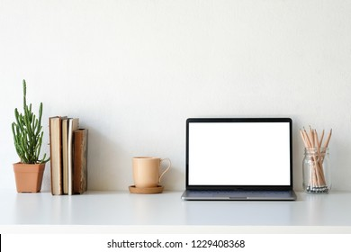 Workplace mockup concept. Mock up home decoration laptop and office supply with copy space for products display montage.