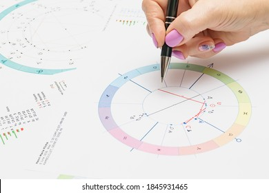 Workplace of a modern astrologer. Astrological charts, charts, tables, diagrams lying on the table.