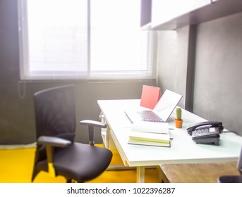 Workplace with notebook laptop work table in office windows