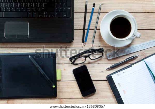 Workplace Notebook Pen Graphics Tablet Keyboard Stock Photo