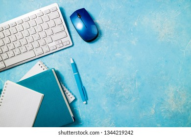 Workplace with office supplies. Office desk with papers, keyboard, notebooks. Business report, office work, deadline and studing  concept. Copy space