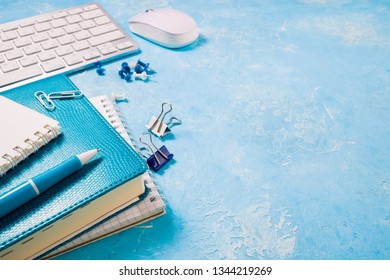 Workplace with office supplies. Office desk with papers, keyboard, notebooks. Business report, office work, deadline and studing  concept