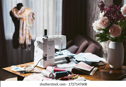 Workplace of a seamstress. Still life with a sewing machine, threads, patterns. The room of an elderly woman. Clothing design. Sewing at home.