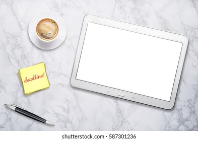 Workplace with tablet and cup of coffee on black table