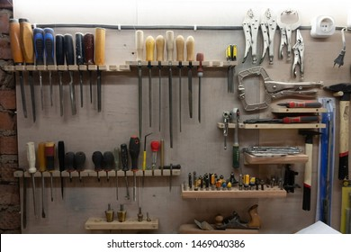 Workplace in the workshop: wall storage of tools