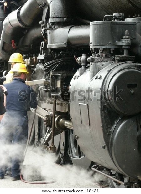 workrs fixing a steam engine