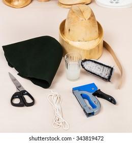 workshop for alpine felt hat making - wool felt hood, wooden dummy and tools for millinery
