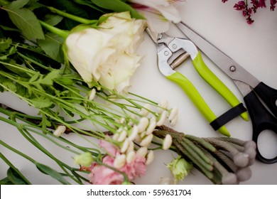 Workshop florist, table with flowers, still life. Soft focus