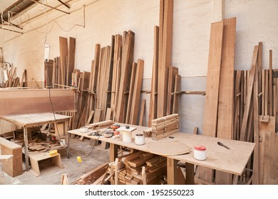 Workshop of a joinery or joinery with workbench and lots of wood