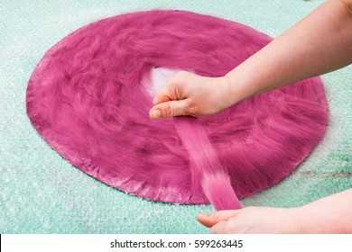 workshop of manufacturing of felt for beret in wet felting process - packing of wool fibers on back side of hat layout