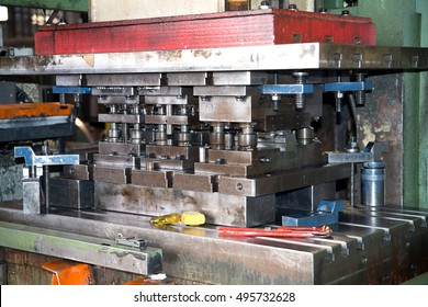 Workshop - Metal forming press. A forming press, commonly shortened to press, is a machine tool that changes the shape of a workpiece by the application of pressure.