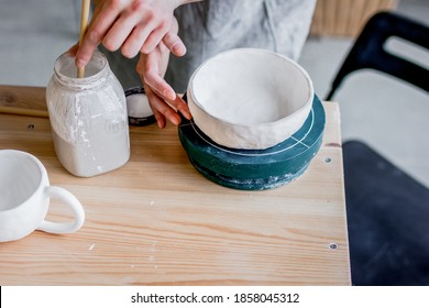 workshop production of ceramic tableware product painting