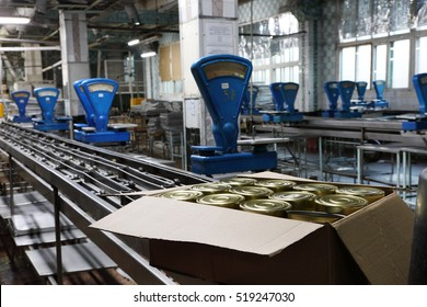 The workshop production of fish products with the old blue scales at the cannery