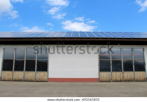 Workshop with two gates, blue sky