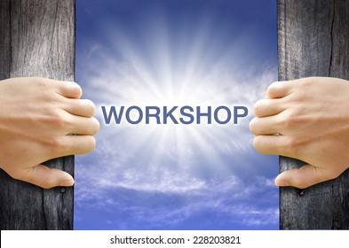 Workshop word floating and shining in the sky while two hands opening an old wooden door.