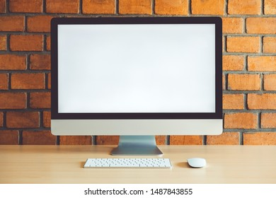 Workspace with Blank Computer Screen in cafe