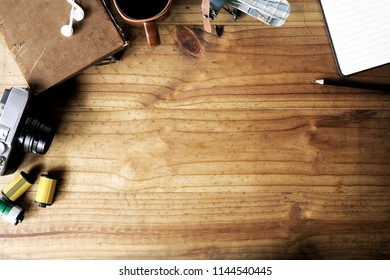 Workspace of creative photographer with tools and copy space on wood desk.
