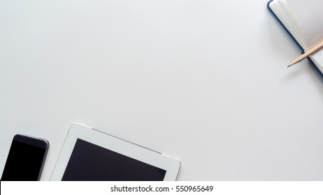 workspace desk with laptop and smart phone copy space background  white