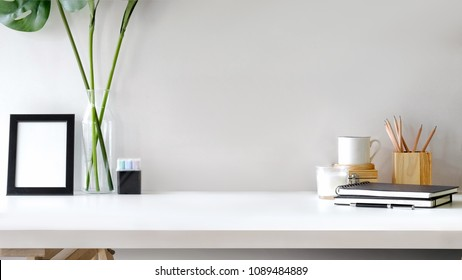 Workspace desk mockup black blank poster and artist accessory with copy space.