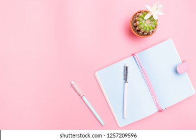 workspace desk styled design office supplies with cactus on pink pastel background minimal style