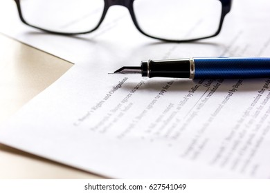 workspace with document, glasses and pen for sign for businessman day
