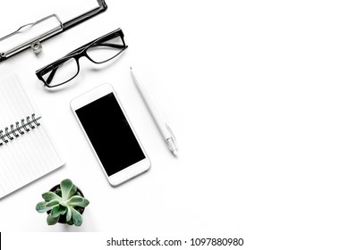Workspace with glasses and notebook office desk white background
