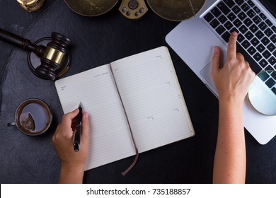 Workspace hero header with law gavel, legal book and laptop keyboard, lawyers hands typing and writting in notebook, top view flatlay lawyer background